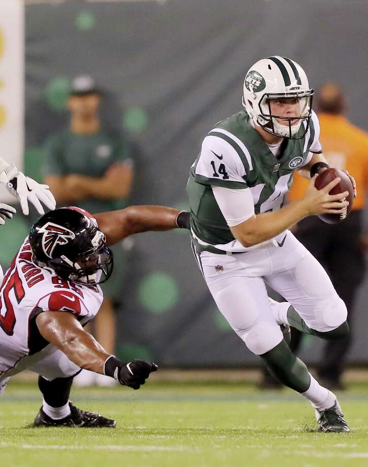 EAST RUTHERFORD, NJ - AUGUST 10:  Sam Darnold #14 of the New York Jets slips away from Jack Crawford #95 of the Atlanta Falcons in the second quarter during a preseason game at MetLife Stadium on August 10, 2018 in East Rutherford, New Jersey.  (Photo by Elsa/Getty Images) Photo: Elsa / 2018 Getty Images