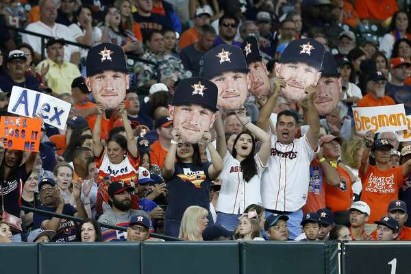 The Bregman Bunch cheer as Alex Bregman comes up to bat during the first inning of an MLB game at Minute Maid Park, Saturday, August 11, 2018, in Houston.