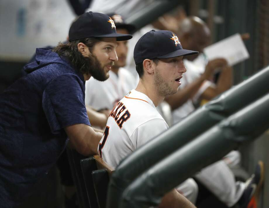 Houston Astros Kyle Tucker talks with injured Jake Marisnick  in the dugout during the fourth inning of an MLB game at Minute Maid Park, Saturday, August 11, 2018, in Houston. Photo: Karen Warren/Houston Chronicle