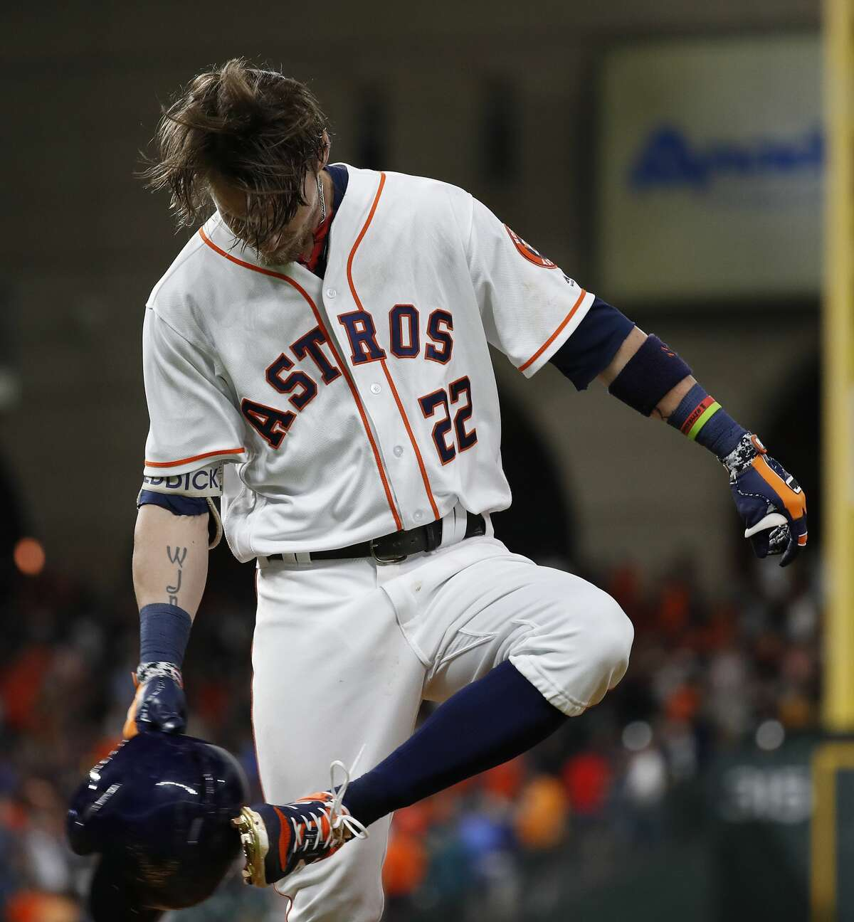 Houston Astros Josh Reddick (22) kicks his batting helmet as he popped out to end the game during an MLB game at Minute Maid Park, Saturday, August 11, 2018, in Houston.