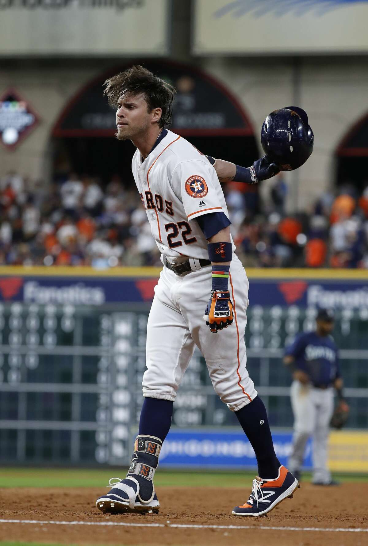 Houston Astros Josh Reddick (22) throws his batting helmet as he popped out to end the game during an MLB game at Minute Maid Park, Saturday, August 11, 2018, in Houston.