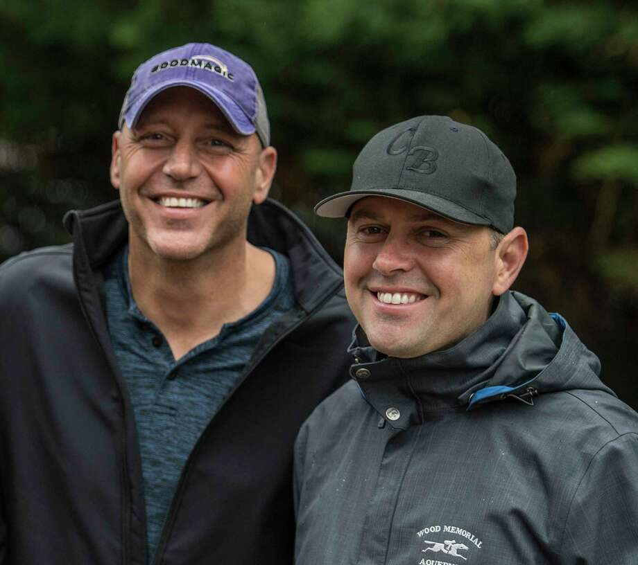 Good Magic's trainer Chad Brown, right,  spends time in the barn area with one of Good Magic's owners Bob Edwards at the Pimlico Race Course on Preakness Day Friday May 18, 2018 in Baltimore, MD. (Skip Dickstein/Times Union) Photo: SKIP DICKSTEIN