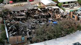 The destruction at Iconic Village Apartments in San Marcos is shown after a devastating fire occurred there July 20. Five people were found dead after the fire.