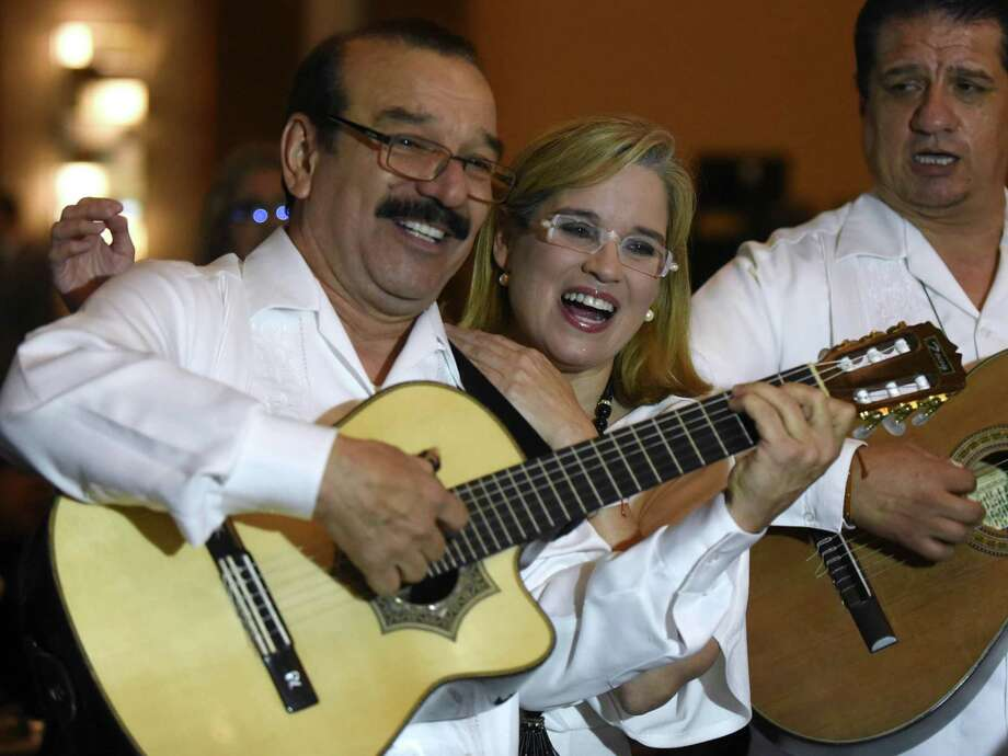 Carmen Yulín Cruz Soto, mayor of San Juan, Puerto Rico, sings with Antonio Rodriguez of the group El Trio Mio at the SAAHJ gala. Photo: Billy Calzada /Staff Photographer / Billy Calzada