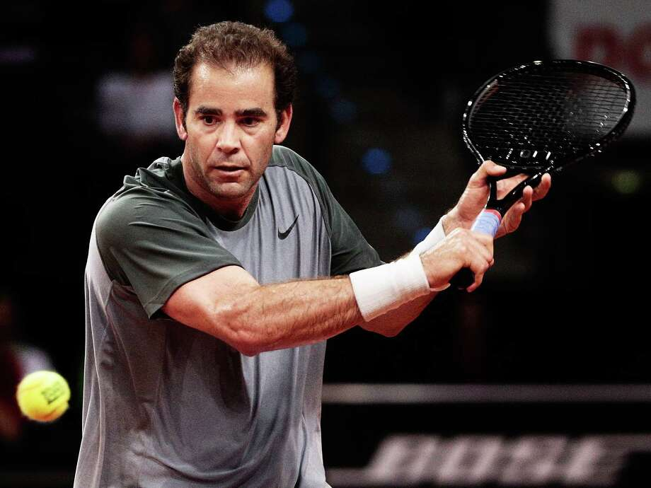 STUTTGART, GERMANY - APRIL 21:  Pete Sampras of the USA hits a backhand during his match against Carlos Moya of Spain on day one of the Porsche Tennis Grand Prix at Porsche-Arena on April 21, 2014 in Stuttgart, Germany.  (Photo by Adam Pretty/Bongarts/Getty Images) ORG XMIT: 485993033 Photo: Adam Pretty / 2014 Getty Images