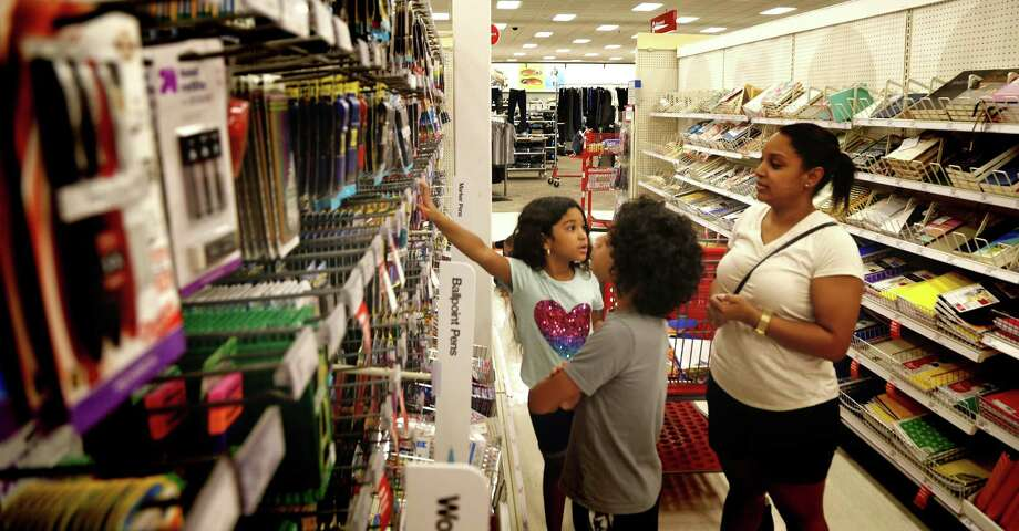Deykaris Villarreal goes shopping for school supplies with her children Josaiah, 9, and Liyanah,7 and saves some money during tax-free weekend at Target on Aug. 11, 2018. Photo: Ronald Cortes /Contributor / 2018 Ronald Cortes