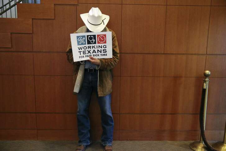 A man shows his support during a public hearing on a proposal for mandatory paid sick leave at the San Antonio City Council Chambers on Aug. 8, 2018. Of the 136 people who signed up to speak, 17 were against the ordinance.