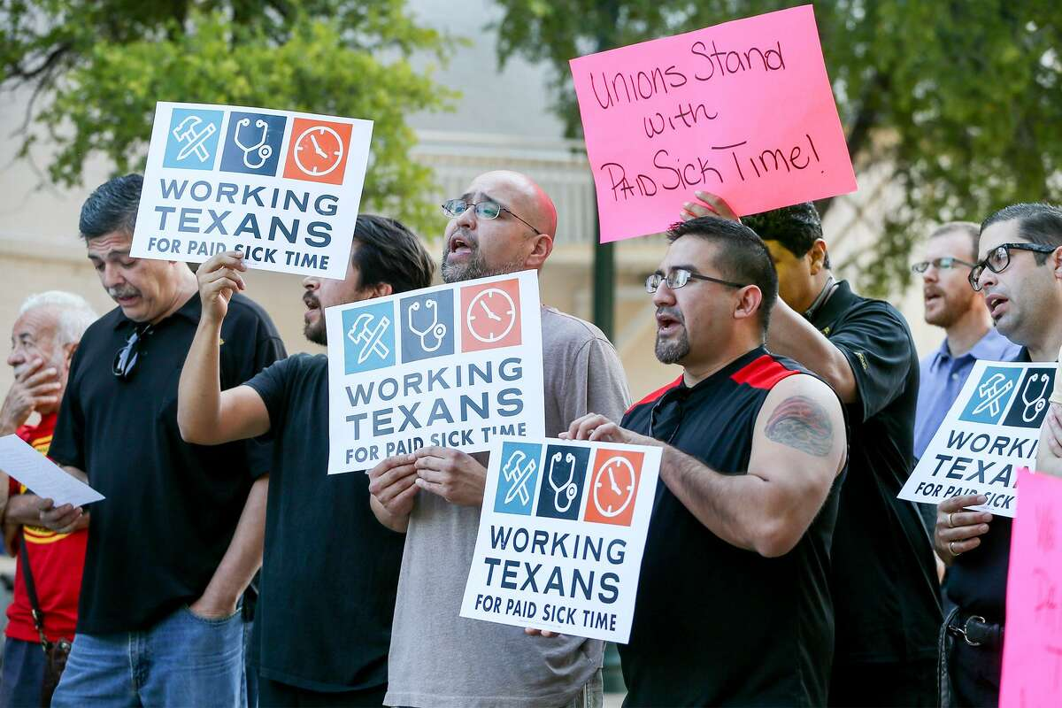 Members of Working Texans for Paid Sick Time rally in front of City Hall before the City Council meets about a proposal for mandatory paid sick leave Aug. 2, 2018.