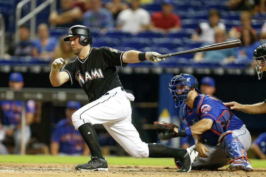 MIAMI, FL - AUGUST 11:  Bryan Holaday #28 of the Miami Marlins hits a walk-off single in the eleventh inning to defeat the New York Mets 4-3 at Marlins Park on August 11, 2018 in Miami, Florida.  (Photo by Michael Reaves/Getty Images) Photo: Michael Reaves / 2018 Getty Images