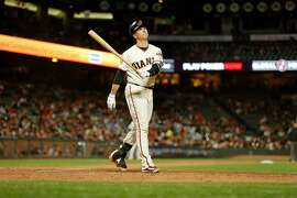 San Francisco Giants catcher Buster Posey (28) takes a moment after swinging and missing the baseball during an MLB game between the San Francisco Giants and Pittsburgh Pirates at AT&T Park on Saturday, Aug. 11, 2018, in San Francisco, Calif. The Pittsburgh Pirates won 4-0.