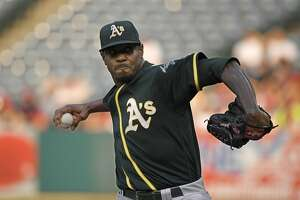 Oakland Athletics starting pitcher Edwin Jackson throws to the plate during the first inning of a baseball game against the Los Angeles Angels Saturday, Aug. 11, 2018, in Anaheim, Calif. (AP Photo/Mark J. Terrill)
