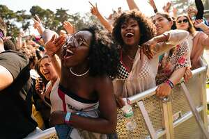 Janice Hodges and Jasia Hodges cheer on during SOB x RBE during Outside Lands Music and Arts Festival at Golden Gate Park in San Francisco, Calif., on Saturday, Aug. 11, 2018.