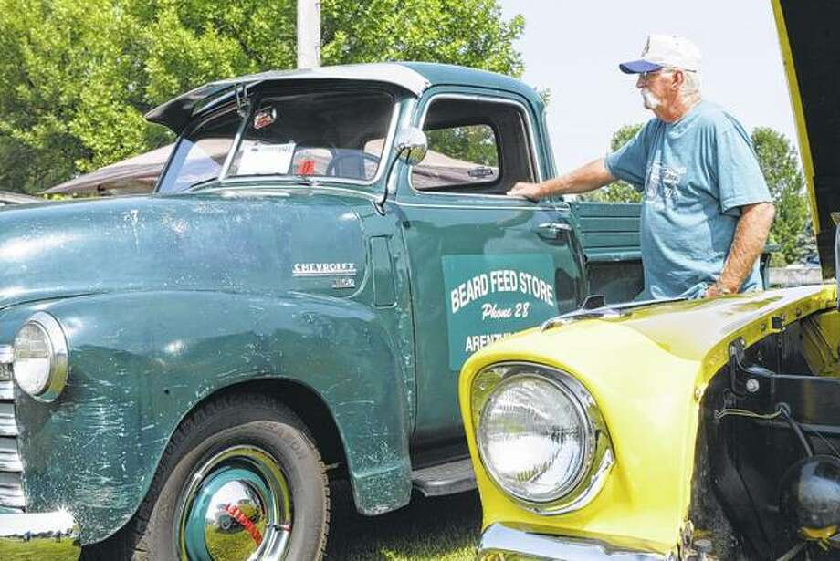 Gary Beard of Arenzville looks at his 1950 Chevrolet five-window pickup truck Saturday at the Thunder in the Park Car, Truck and Motorcycle Show in Arenzville. Photo:       Greg Olson | Journal-Courier