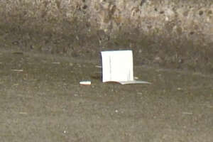 A shooter in another car pulled up and fired 40 shots into a couple's vehicle late Saturday night.
