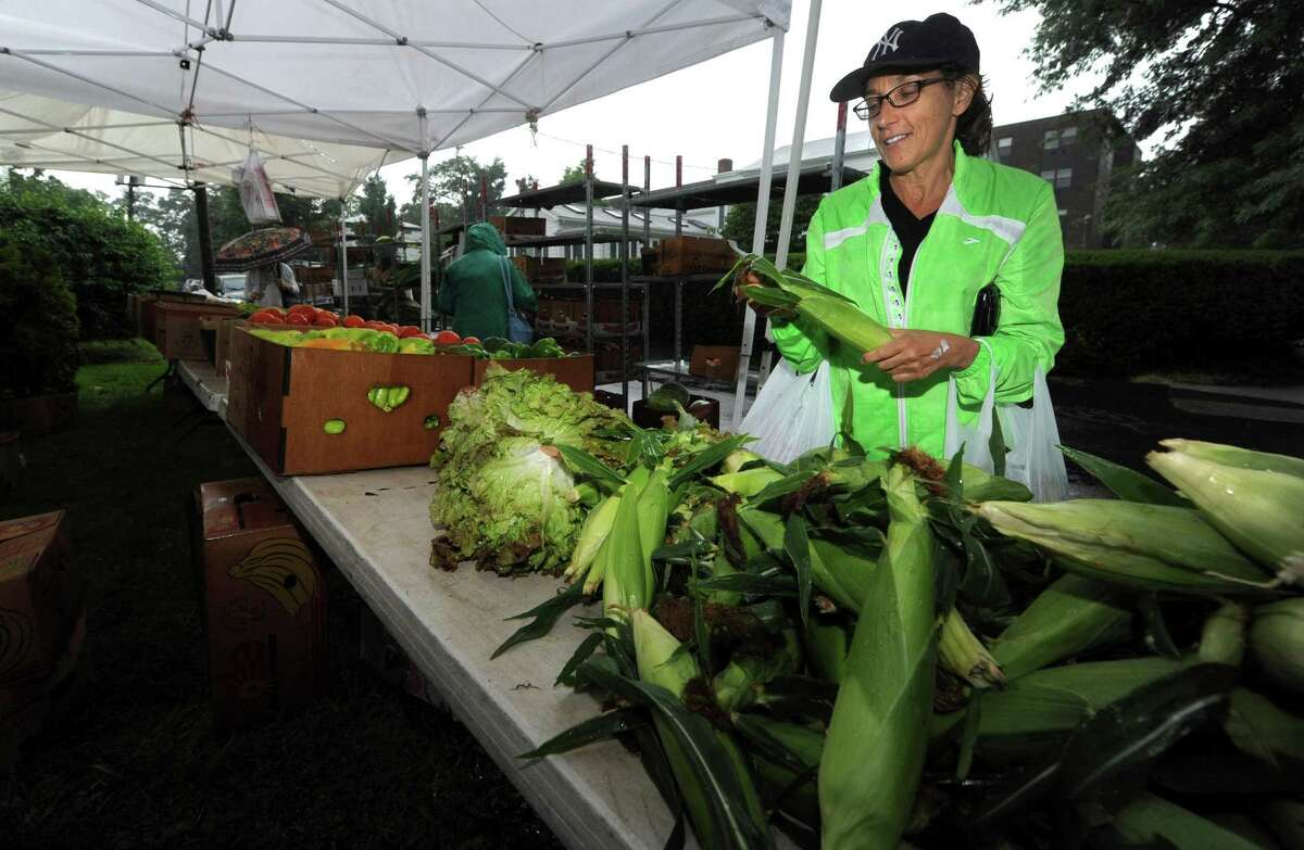 Norwalk's Roberta Andreasi shops for produce during the First Congregational Church Farmers Market on Saturday at the church in Norwalk. The farmers market is hosted by Norwalk Green Association and offers discounts for EBT recipients and runs through October.
