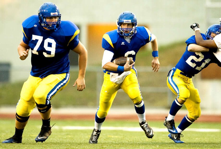Midland High's Andrew Wylie (left) and Toby Wilson block for quarterback Alex Rapanos against Flint Southwestern in this 2010 Daily News file photo. Photo: Daily News File Photo