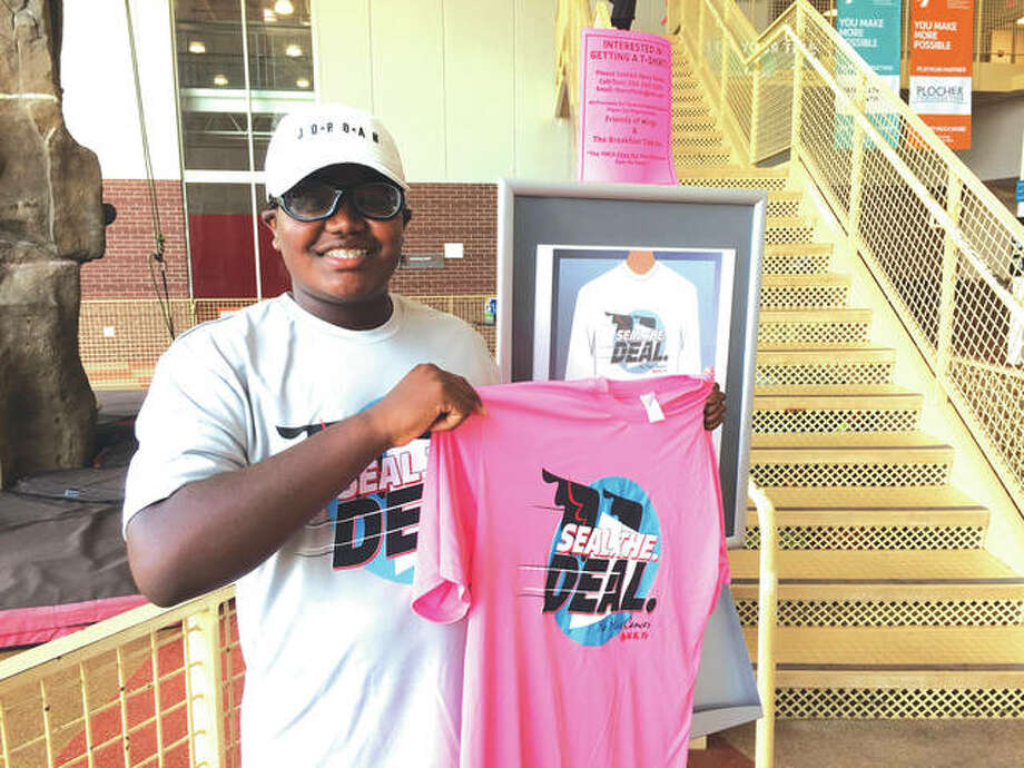 Harrison Reed-Parker with one of his Seal the Deal t-shirts at the YMCA's Meyer Center.