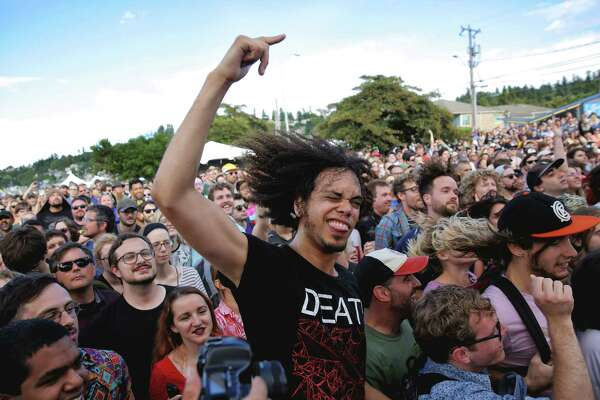 Fans dance during Clipping's set at Sup Pop Records' 30th anniversary party at Alki Beach, Saturday, Aug. 11, 2018. The free event included four stages with Sub Pop signed bands playing throughout the afternoon and evening.