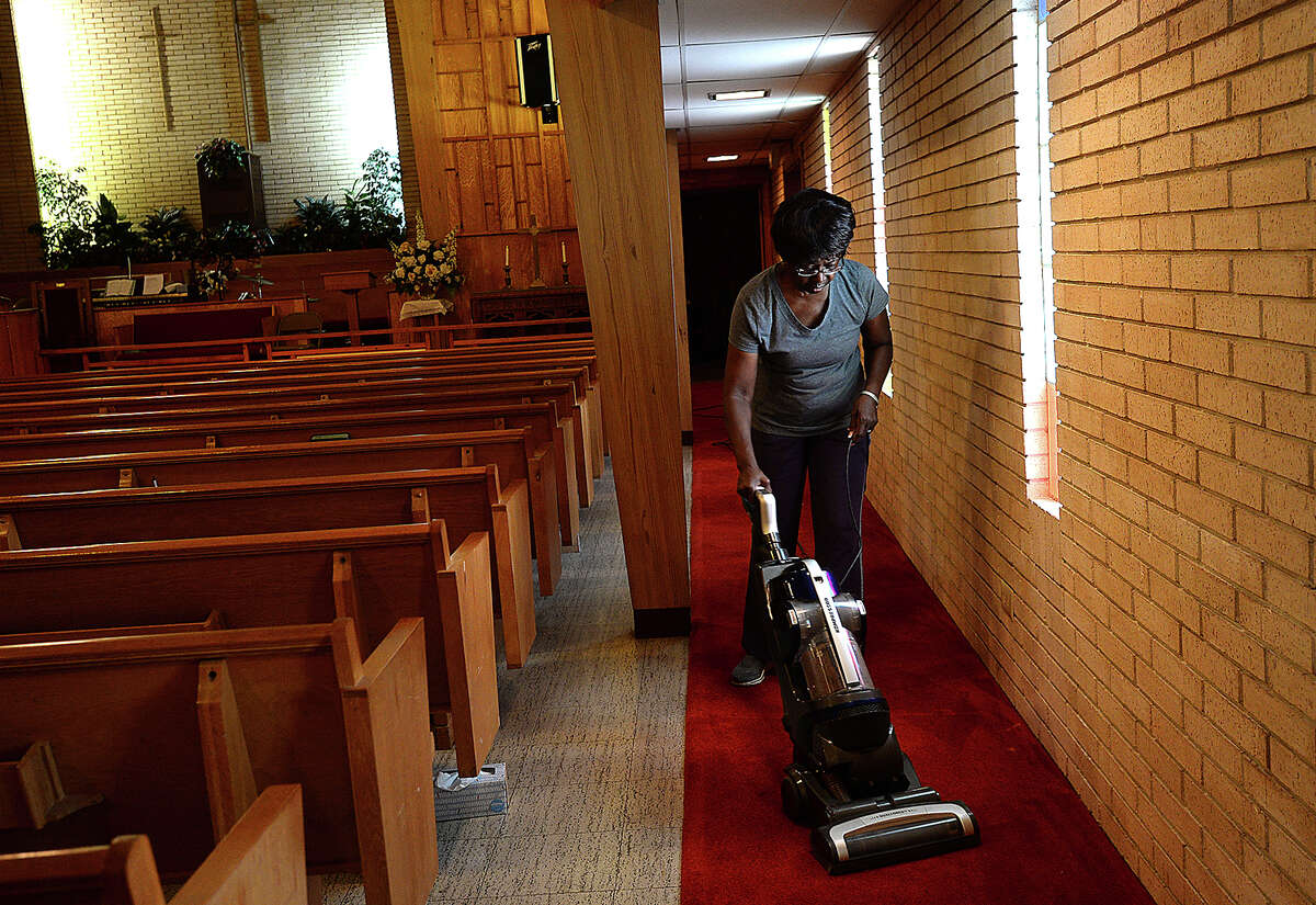 Marilyn Smith cleans in the sanctuary at St. Paul African Methodist Episcopal Church in Beaumont as she helps prepare for the church's 150th anniversary this Sunday. St. Paul's started in 1868 and met at the home of Rev. Woodson Pipkin, a former slave. It has been at its current location on Waverly Street since 1964, where it also served as a hub for local meetings and activities during the Civil Rights Movement. Thursday, August 9, 2018 Kim Brent/The Enterprise