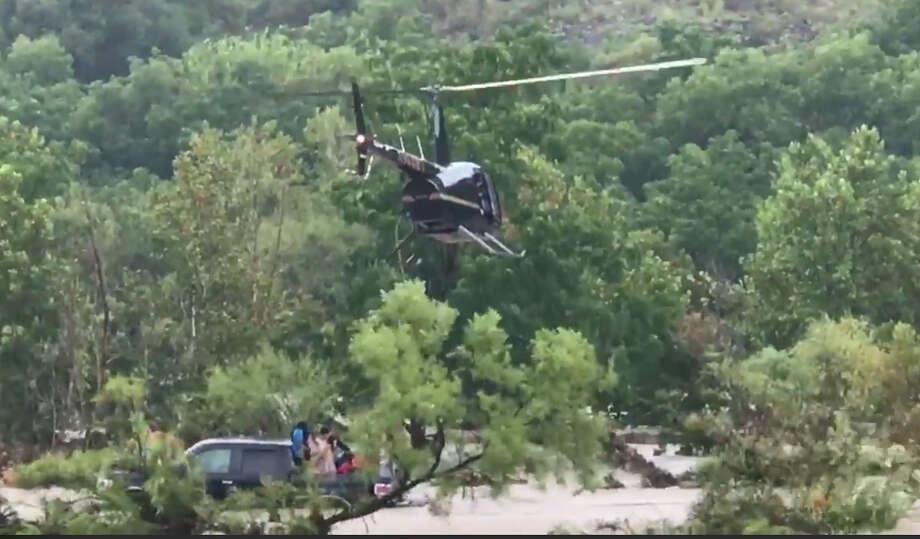 August 12, 2018 - From the Uvalde County Sheriff's Office: Rescue efforts continue at Chalk Bluff Park. Holt Helicopters are on scene assisting all emergency personnel and delivering life jackets to persons in the river. Photo: Uvalde County Sheriff's Office