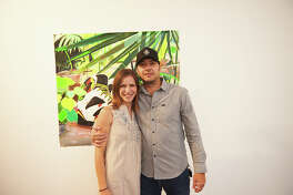 San Antonio residents admired the history of their favorite footwear at the Sneakerhead: The Art of Kicks on Friday, Aug. 11, 2018, at the Freight Gallery & Studios.