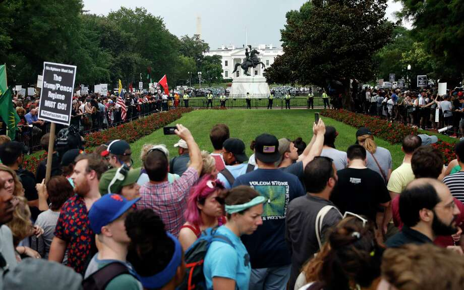 "Demonstrators rally near the White House on the one year anniversary of the Charlottesville ""Unite the Right"" rally, Sunday, Aug. 12, 2018, in Washington. (AP Photo/Jacquelyn Martin) Photo: Jacquelyn Martin, Associated Press / Associated Press/Jacquelyn Martin"