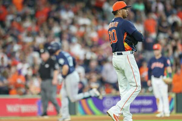 Houston Astros relief pitcher Hector Rondon (30) reacts to Seattle Mariners right fielder Mitch Haniger (17) home run during an MLB game at Minute Maid Park Sunday, Aug. 12, 2018, in Houston.