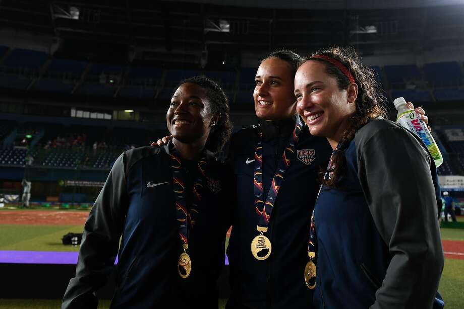 Pleasanton native and Cal alum Val Arioto (right) celebrates her new worlds gold medal with Michelle Moultrie (left) and Delaney Spaulding. Photo: Takashi Aoyama / Getty Images