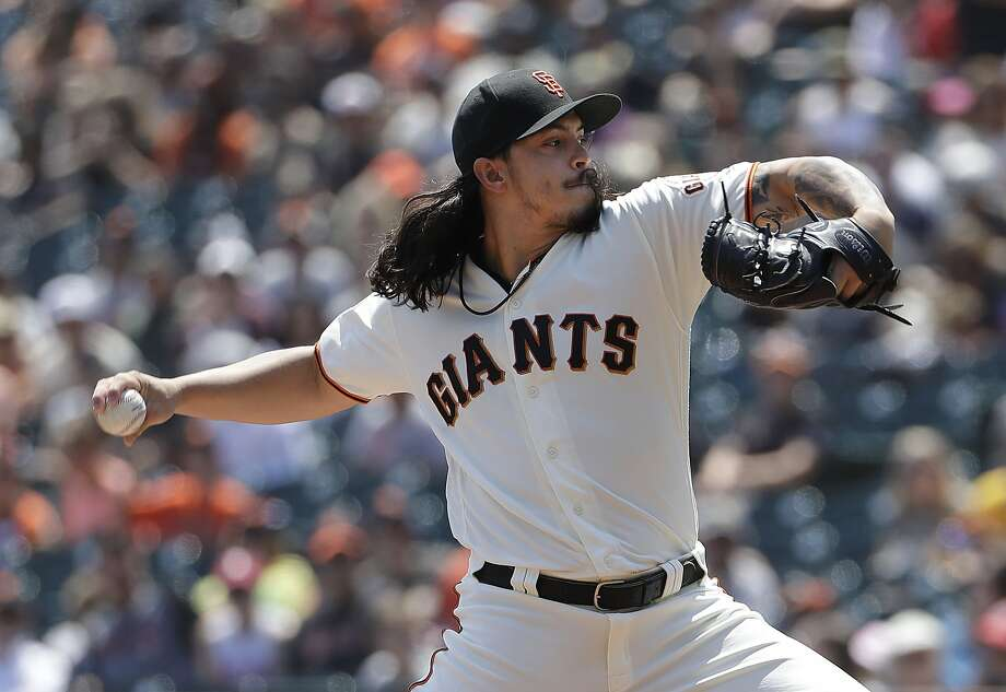 San Francisco Giants pitcher Dereck Rodriguez throws against the Pittsburgh Pirates during the first inning of a baseball game in San Francisco, Sunday, Aug. 12, 2018. (AP Photo/Jeff Chiu) Photo: Jeff Chiu / Associated Press