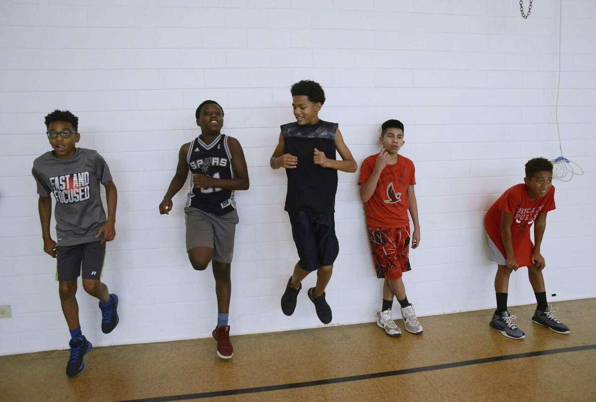 Boys ages 12-17 prepare to participate in a 100 Black Men of San Antonio basketball practice earlier this summer.