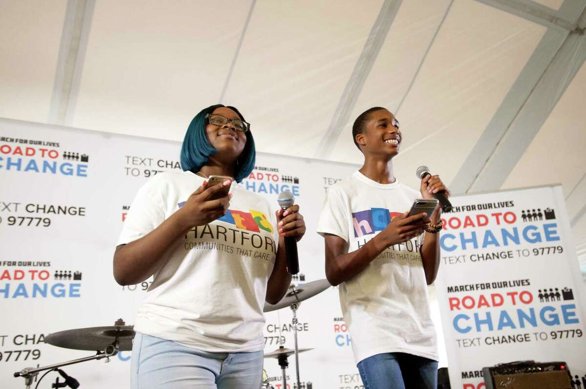 Activists from the Communities That Care group in Hartford smile while speaking during the Road to Change Tour, which featured members of Sandy Hook Promise and activists from March For Our Lives coming together, at the Fairfield Hills Campus in Newtown, Conn. on Sunday, Aug. 12, 2018. March for Our Lives, which was created by student survivors of the Stoneman Douglas High School shooting , joined the local gun control activists on the last stop of their tour.