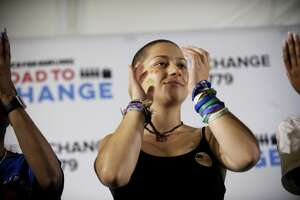 Emma Gonzalez, a vocal gun controladvocate and Stoneman Douglas High School shooting survivor, claps while listening to Martin Luther King Jr.'s granddaughter Yolanda Renee King during the Road to Change Tour at the Fairfield Hills Campus in Newtown on Sunday.