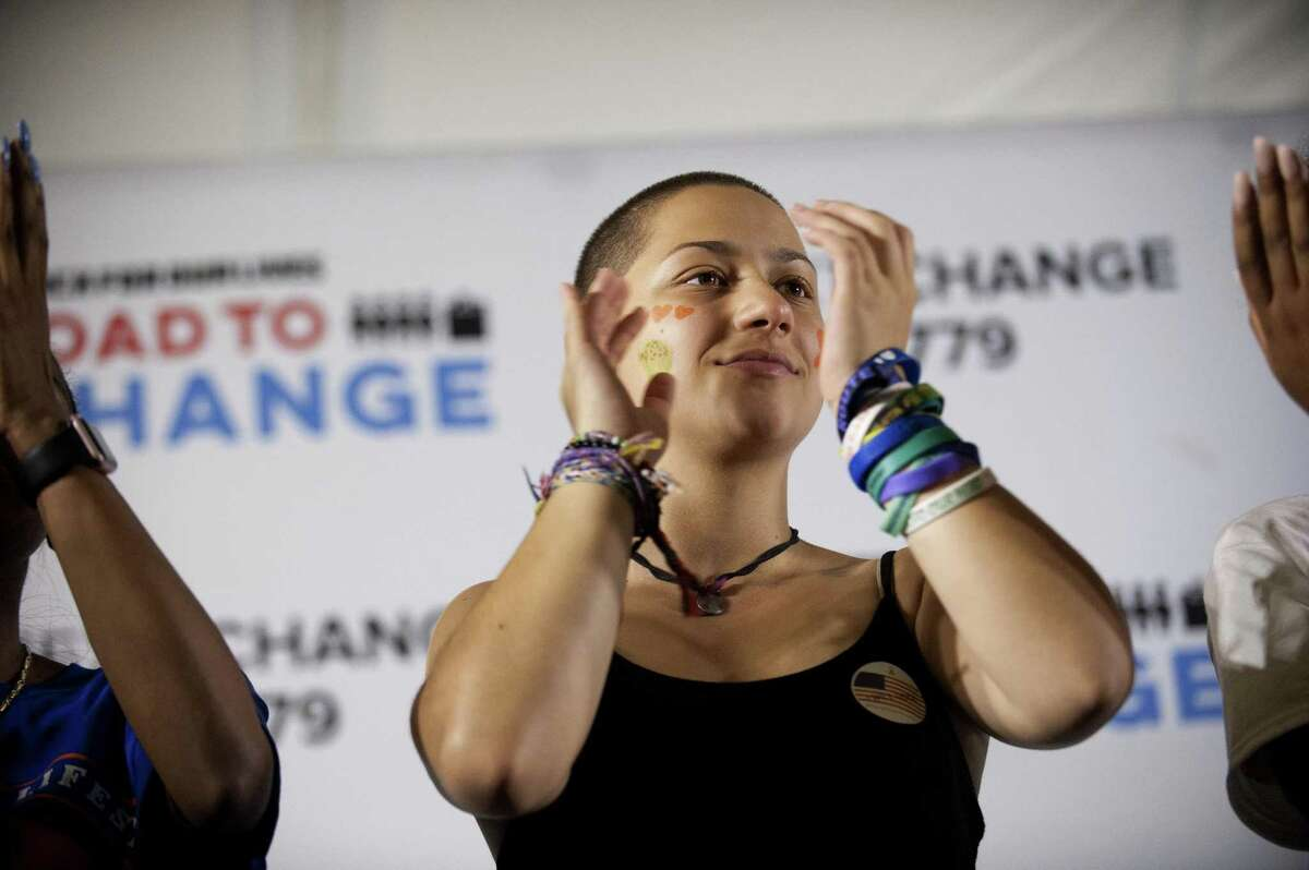 Emma Gonzalez, a vocal gun control advocate and Stoneman Douglas High School shooting survivor, claps while listening to Martin Luther King Jr.'s granddaughter Yolanda Renee King during the Road to Change Tour at the Fairfield Hills Campus in Newtown on Sunday.