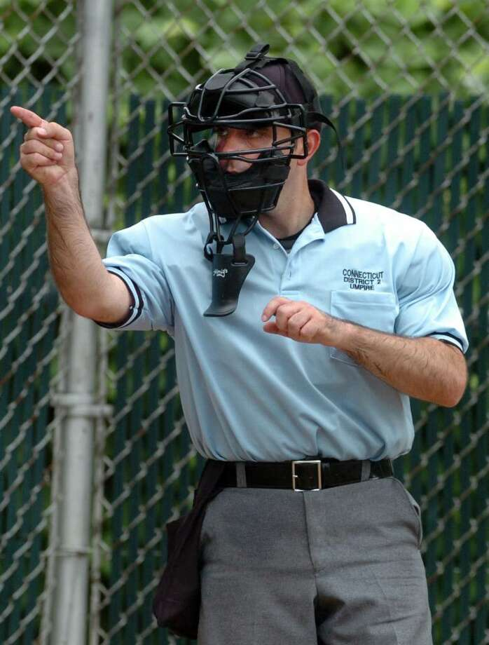 Umpire Rob Bleggi makes a call Saturday July 10, 2010 during game action between Fairfield National and Trumbull National at Blackham School in Bridgeport.  Bleggi will be umpiring in the Little League World Series in Pennsylvania in August. Photo: Autumn Driscoll / Connecticut Post