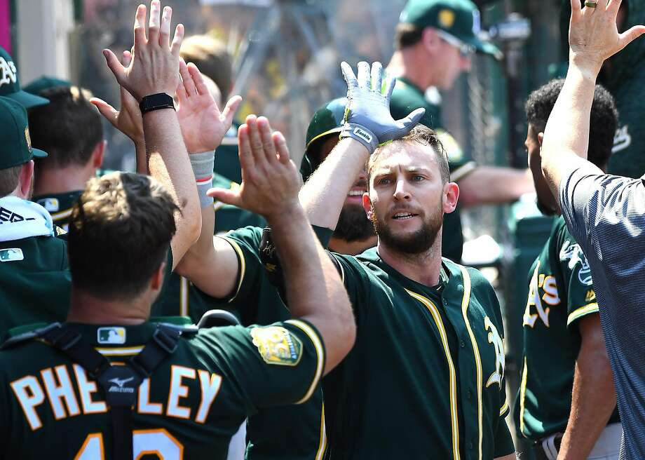 ANAHEIM, CA - AUGUST 12:  Jed Lowrie #8 of the Oakland Athletics is congratulated in the dugout after hitting a three run home run in the fourth inning of the game against the Los Angeles Angels of Anaheim at Angel Stadium on August 12, 2018 in Anaheim, California.  (Photo by Jayne Kamin-Oncea/Getty Images) Photo: Jayne Kamin-Oncea / Getty Images