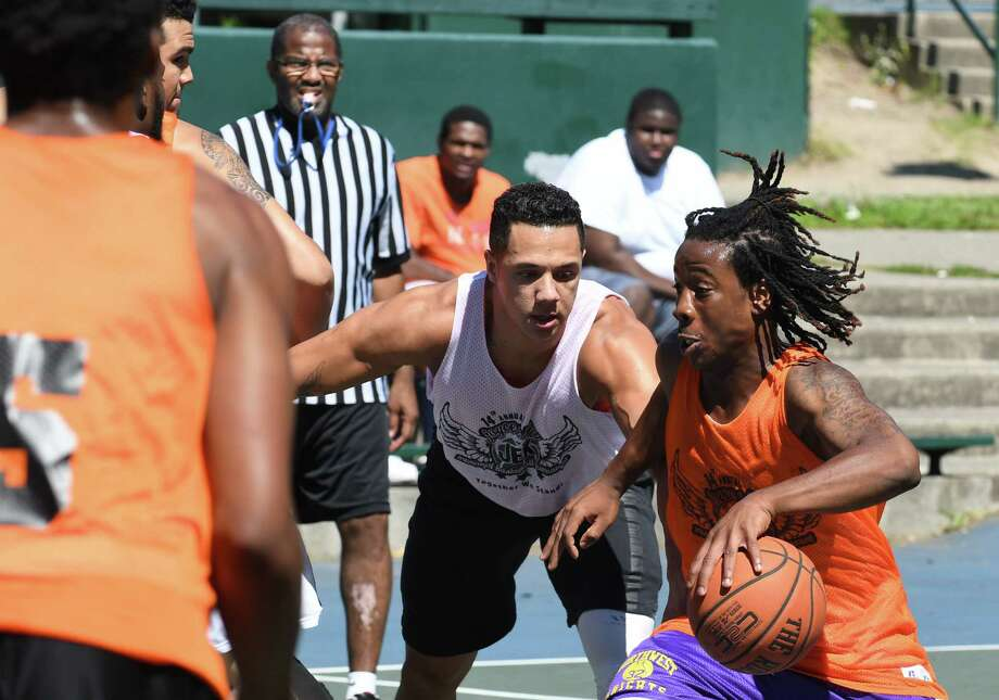 Players compete in the 14th annual Joyce E. King Memorial Basketball tournament at Arbor Hill Park on Saturday Aug. 20, 2016 in Albany, N.Y. (Michael P. Farrell/Times Union) Photo: Michael P. Farrell, Albany Times Union / 20037737A