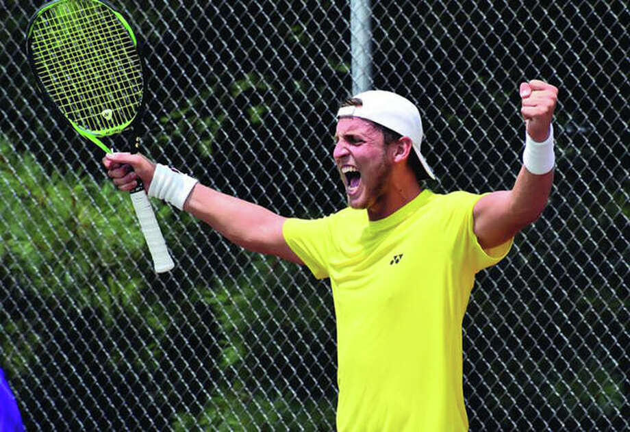 Axel Geller celebrates after winning the USTA Edwardsville Futures in a three-set tiebreaker on Sunday at the EHS Tennis Center. It was the first Futures championship for Geller, who is from Buenos Aires, Argentina. Photo:       Matthew Kamp / Hearst Newspapers