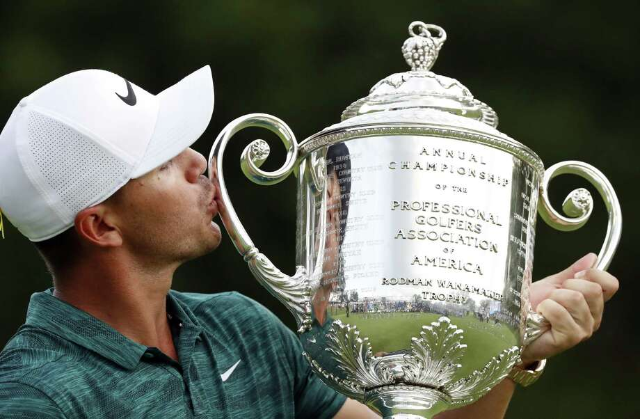 Brooks Koepka kisses the Wanamaker Trophy after he won the PGA Championship golf tournament at Bellerive Country Club, Sunday in St. Louis. Photo: Brynn Anderson, STF / Associated Press / Copyright 2018 The Associated Press. All rights reserved