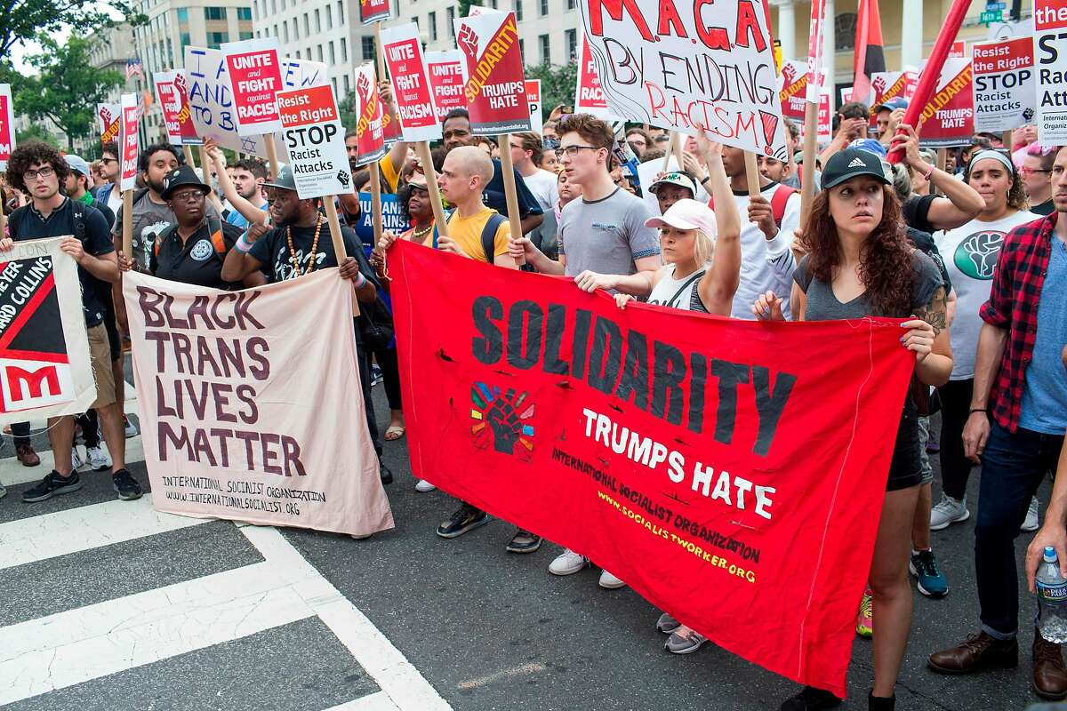 Counter protestors to a far-right rally march during the Unite the Right 2 Rally in Washington, DC, on August 12, 2018. - Last year's protests in Charlottesville, Virginia, that left one person dead and dozens injured, saw hundreds of neo-Nazi sympathizers, accompanied by rifle-carrying men, yelling white nationalist slogans and wielding flaming torches in scenes eerily reminiscent of racist rallies held in America's South before the Civil Rights movement. (Photo by ZACH GIBSON / AFP)ZACH GIBSON/AFP/Getty Images