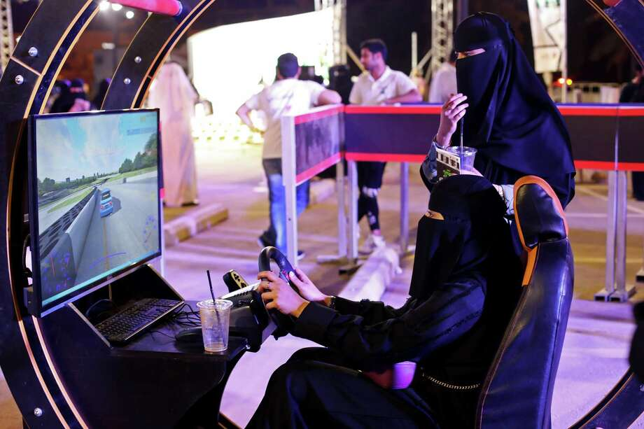 Saudi women try out a driving simulator at an educational driving event at Riyadh Park Mall in Riyadh, Saudi Arabia, on Saturday, June 23, 2018. Lifting the ban on driving is likely to increase the number of women seeking jobs and could add about $90 billion to economic output by 2030 — as much income as plans to sell shares in the national oil company. Photo: Maya Anwar / Bloomberg / © 2018 Bloomberg Finance LP