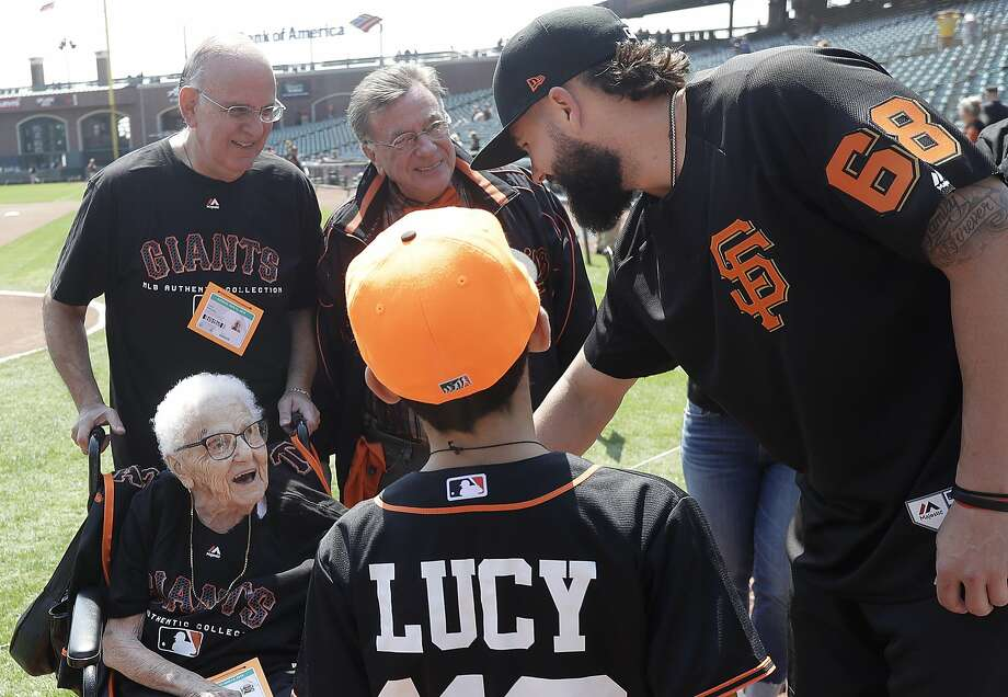 San Francisco Giants pitcher Casey Kelly, right, greets Lucy Mirigian, bottom left, and members of her family as they celebrate her 112th birthday before a baseball game between the Giants and the Pittsburgh Pirates in San Francisco, Sunday, Aug. 12, 2018. (AP Photo/Jeff Chiu) Photo: Jeff Chiu, Associated Press