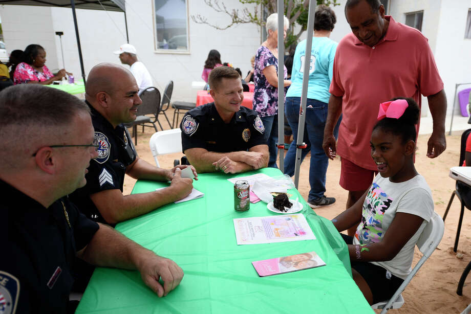 Interim chief of police Seth Herman, center, talks to community members during a back-to-school cookout event at Mount Moriah Disciples of Christ Church on Saturday. The event featured a school-supply giveaway and activities for children, as well as the opportunity for members of the Midland Police Department to interact with residents. Photo: James Durbin/Reporter-Telegram / ? 2018 Midland Reporter-Telegram. All Rights Reserved.