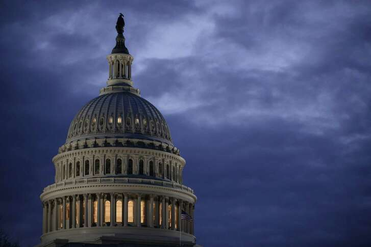 In a file photo from March 30, 2017, the Capitol Dome is seen at dawn in Washington.