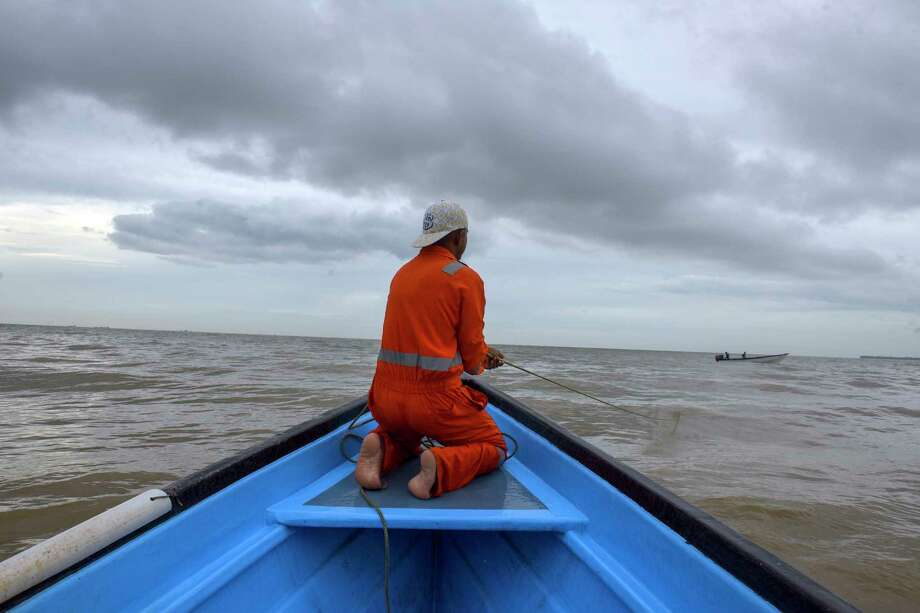 A fisherman on July 12, 2018, rides in a boat where some have been either robbed and/or killed by Venezuelan pirates or had their livelihoods of fishing affected by the increasing criminality of piracy on the waters between Venezuela and Trinidad. Photo: Washington Post Photo By Jahi Chikwendiu / The Washington Post
