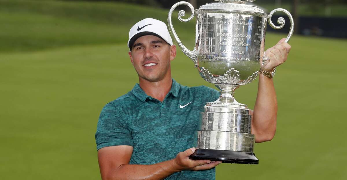 Brooks Koepka poses with the Wanamaker Trophy after winning the PGA Championship golf tournament at Bellerive Country Club, Sunday, Aug. 12, 2018, in St. Louis. (AP Photo/Jeff Roberson)