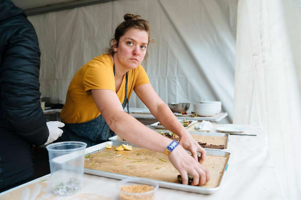Chef Christa Chase at Tartine Manufactory prepares food for a wine and food pairing with Eric Wareheim and Joel Burt at Outside Lands Music and Arts Festival at Golden Gate Park in San Francisco, Calif., on Sunday, Aug. 12, 2018. Both are the winemakers behind Las Jaras Wines.