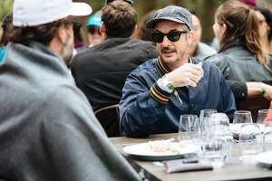 Winemaker, Joel Burt, talks to actor, Eric Wareheim,  through a wine and food pairing event with Chef Christa Chase at Tartine Manufactory at Outside Lands Music and Arts Festival at Golden Gate Park in San Francisco, Calif., on Sunday, Aug. 12, 2018. Both are the winemakers behind Las Jaras Wines.