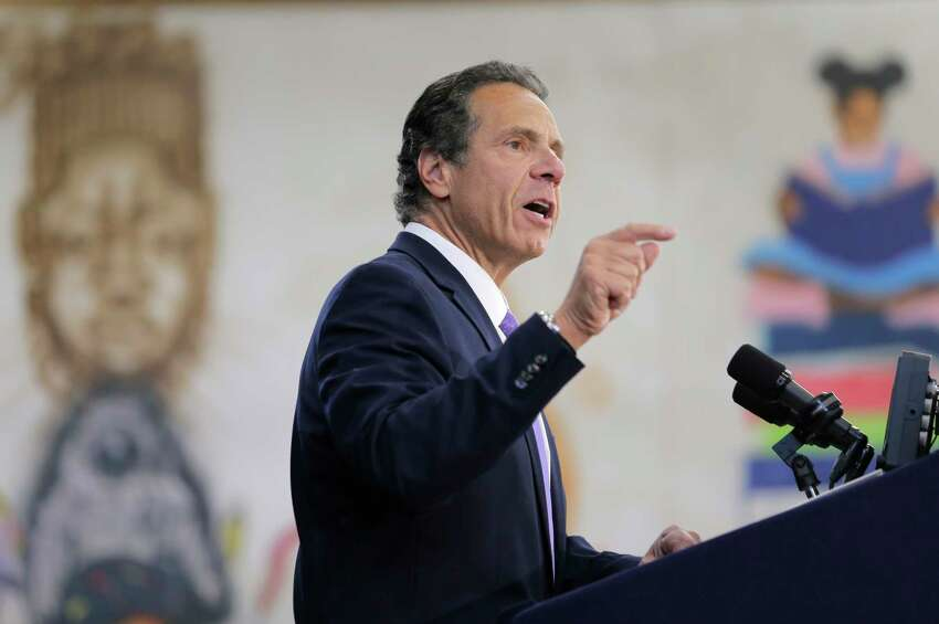FILE - In this July 5, 2018, file photo, New York Gov. Andrew Cuomo speaks at an event in the Brownsville section of Brooklyn in New York. At an event in the Adirondacks, Cuomo recounted a treasured memory of the time his family retrieved an eagle feather from Saranac Lake and kept it after one of the beautiful birds swooped near his canoe. In telling the story, the New York Democrat was unknowingly confessing a crime. A federal law prohibits non-Native Americans from possessing bald eagle parts, including feathers. (AP Photo/Seth Wenig, File)