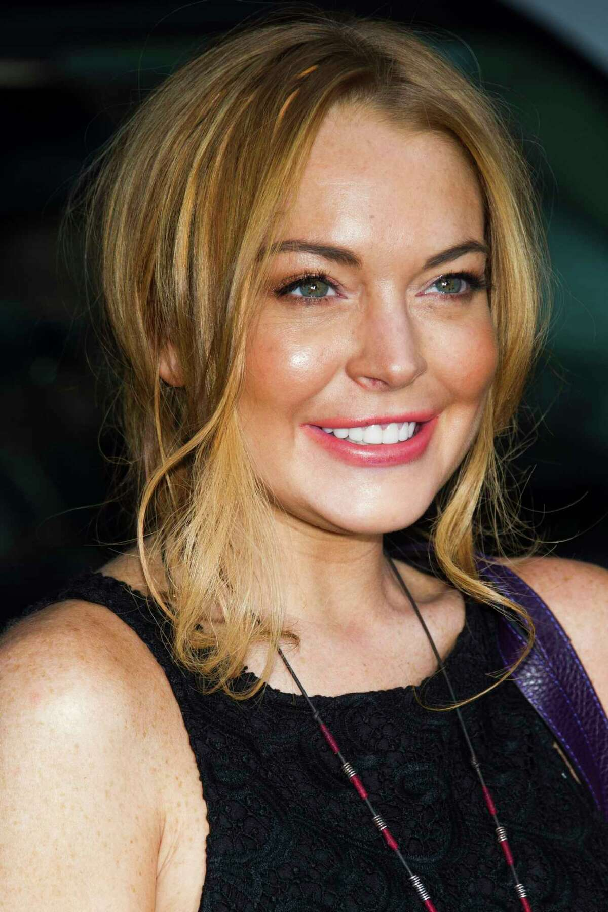 Lindsay Lohan leaves an appearance on the