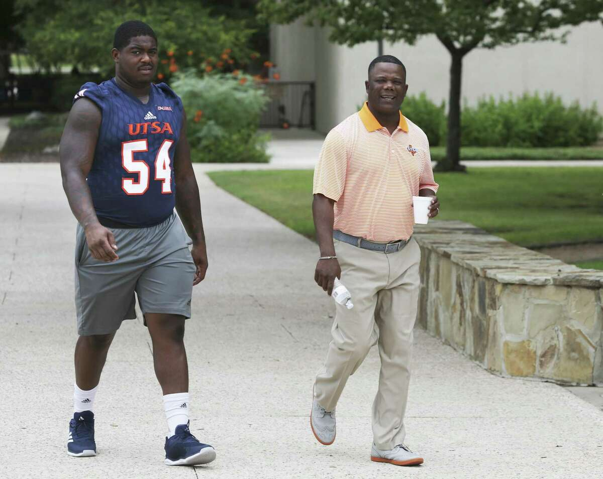 UTSA coach Frank Wilson (right) may not have Marcus Davenport around anymore, but senior defensive tackle Kevin Strong Jr. is ready to pick up where the New Orleans Saints' first-round draft pick left off by leading the Roadrunners' defense in 2018.